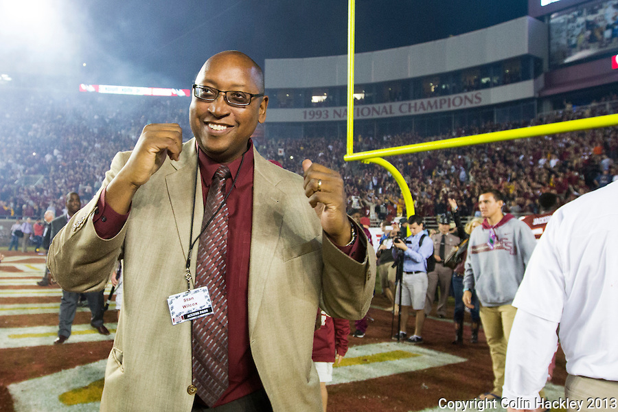 TALLAHASSEE, FL 11/2/13-FSU-MIAMI110213CH-Florida State Athletic Director Stan Wilcox celebrates beating Miami 41-14 Saturday at Doak Campbell Stadium in Tallahassee. <br /> COLIN HACKLEY PHOTO