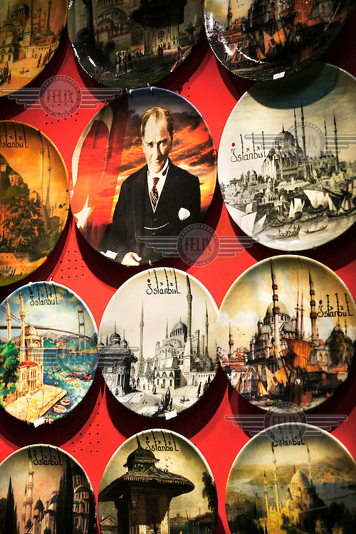 Plates painted with images of Istanbul and Ataturk for sale in the Grand Bazaar, which is one of the world's largest covered markets, famous for its carpets shops, and with more then 58 streets and over 1,200 shops.
