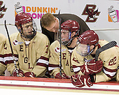 Isaac MacLeod (BC - 7), Greg Brown (BC - Assistant Coach), Brian Dumoulin (BC - 2), Paul Carey (BC - 22) - The Boston College Eagles defeated the visiting University of New Hampshire Wildcats 4-3 on Friday, January 27, 2012, in the first game of a back-to-back home and home at Kelley Rink/Conte Forum in Chestnut Hill, Massachusetts.