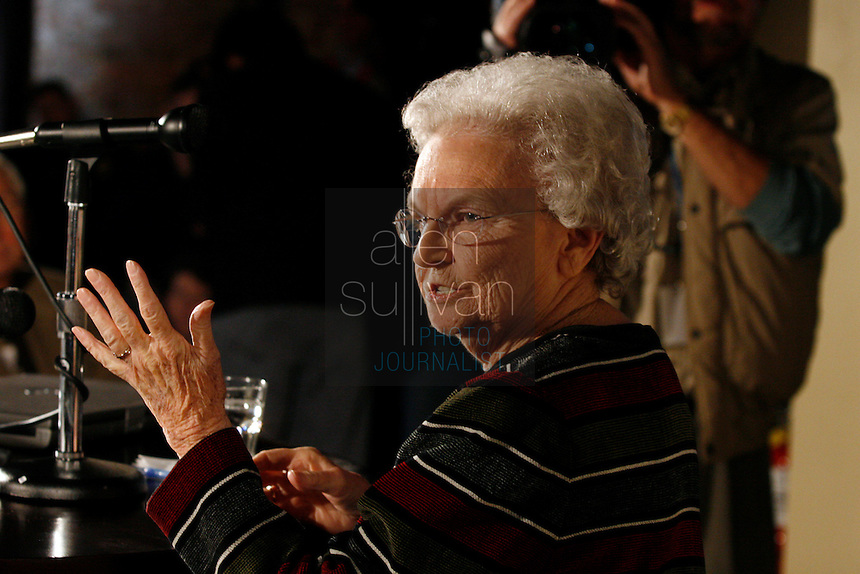 Margaret Foster (cq) speaks to people gathered at The Spotted Dog--which used to house Fire Station 11--during a commemoration to mark the 60th anniversary of the Winecoff Hotel fire in downtown Atlanta. Foster, with her husband and daughter, were staying at the hotel on the night of the fire. They all survived. The fire--at 119 deaths, the worst hotel fire in U.S. history--caused departments across the country to update their fire safety codes.