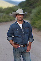 handsome cowboy outdoors in New Mexico