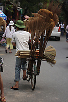Hanoi<br /> , Vietnam - 2007 File Photo -<br /> A man on a bicycle carrie brooms for sale<br /> in Hanoi street.<br /> <br /> <br /> <br /> <br /> <br /> photo : James Wong-  Images Distribution