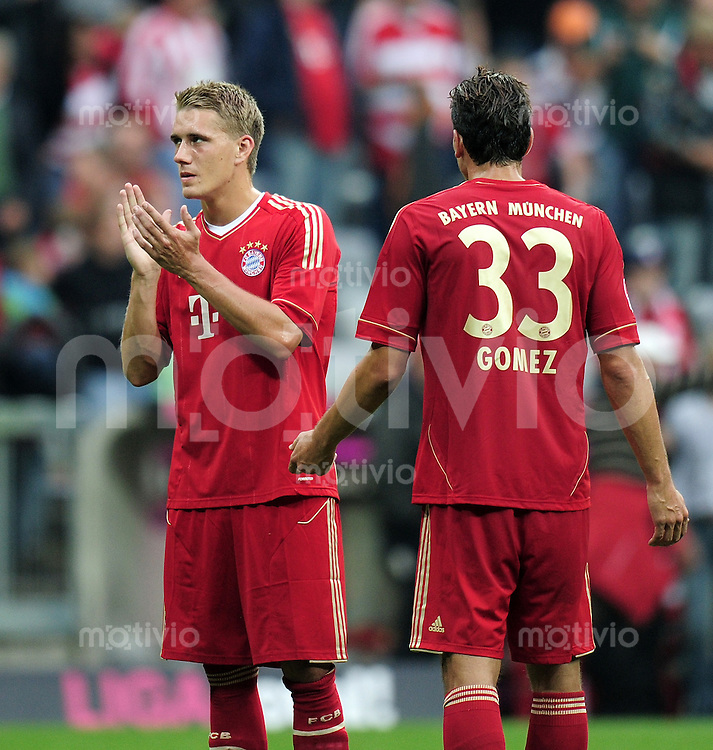 FUSSBALL   1. BUNDESLIGA  SAISON 2011/2012   1. Spieltag FC Bayern Muenchen - Borussia Moenchengladbach           07.08.2011 Nils Petersen , Mario Gomez (v. li., FC Bayern Muenchen)