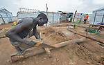A man constructs a shelter inside a United Nations base in Juba, South Sudan, where some 34,000 people have sought protection since violence broke out in December 2013. More than 112,000 people currently live on UN bases in the war-torn country, most of them afraid of tribally targeted violence.