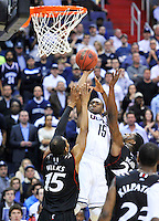 Despite the tough defense, Kemba Walker of the Huskies gets off a clean jump shot. UConn defeats Cincinnati 69-58 during the 3rd round of the NCAA Tournament at the Verizon Center in Washington, D.C on Saturday, March 19, 2011. Alan P. Santos/DC Sports Box