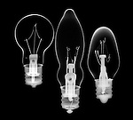 X-ray image of three incandescent bulbs (white on black) by Jim Wehtje, specialist in x-ray art and design images.