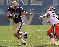 Pitt wide receiver Mike Shanahan (87) strikes a Heisman pose while avoiding a Syracuse defender.The Pittsburgh Panthers beat the Syracuse Orange 33-20 at Heinz Field in Pittsburgh, Pennsylvania on December 3, 2011