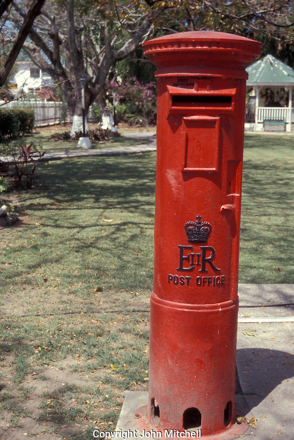 Old fashioned English post box or pillar box outside Government House in Belize City, Belize