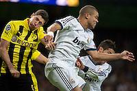 Pepe and Cristiano Ronaldo fighting a hard aerial ball