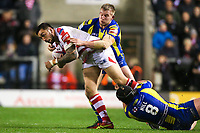 Picture by Alex Whitehead/SWpix.com - 16/03/2017 - Rugby League - Betfred Super League - Leigh Centurions v Warrington Wolves - Leigh Sports Village, Leigh, England - Leigh's Harrison Hansen is tackled by Warrington's Chris Hill and Mike Cooper.