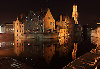 BRUGES, BELGIUM - FEBRUARY 06 : A panoramic view of the canals from Rozenhoedkaai by night on February 06, 2009 in Bruges, West Flanders, Belgium. The well-lit 'Beffroi' (Belfort), built in 1240 and listed by the UNESCO as World Heritage Site, is the most recognizable point of the island. (Photo by Manuel Cohen)