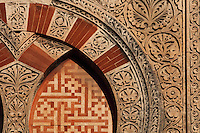 Architectural detail of the Puerta de San Ildefonso, built under Al-Hakam II in the 10th century, one of the West facade entrances to the Cathedral-Great Mosque of Cordoba, on the Calle Torrijos in Cordoba, Andalusia, Southern Spain. This detail shows the intricately carved vegetal patterns and an overlapping arch design. The first church built here by the Visigoths in the 7th century was split in half by the Moors, becoming half church, half mosque. In 784, the Great Mosque of Cordoba was begun in its place and developed over 200 years, but in 1236 it was converted into a catholic church, with a Renaissance cathedral nave built in the 16th century. The historic centre of Cordoba is listed as a UNESCO World Heritage Site. Picture by Manuel Cohen