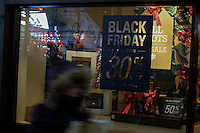 A woman pass by a store with Black friday promotion in New York.  10.28.2014. Eduardo Munoz Alvarez/VIEWpress