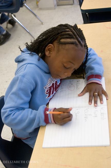 Oakland CA 2nd grade student working on spelling words in class