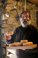 Corte, Corsica, France, September 2012. shepherd and cheese maker Jean Paul Chiesi stays 4 ½ -5 months per year on the mountain to make his cheeses. The Vallée de la Restonica is one of the prettiest spots in all of Corsica. The river, rising in the grey-green mountains, has scoured little basins in the rock, offering sheltered pinewood settings for swimming, sunbathing and picnicking. From Corte, the D623 winds its way through the valley for 15km to the Bergeries de Grotelle, a huddle of shepherds' huts which offer local cheeses and cured meats. Corsica is a wildly beautiful French island, scented with myrtle and possessing one of the most diverse landscapes in Europe, from crescent bays with white-sand beaches to montane forests sheltering rugged granite peaks, with miles of untouched coastline, sun-splashed mountain villages. Photo by Frits Meyst/Adventure4ever.com