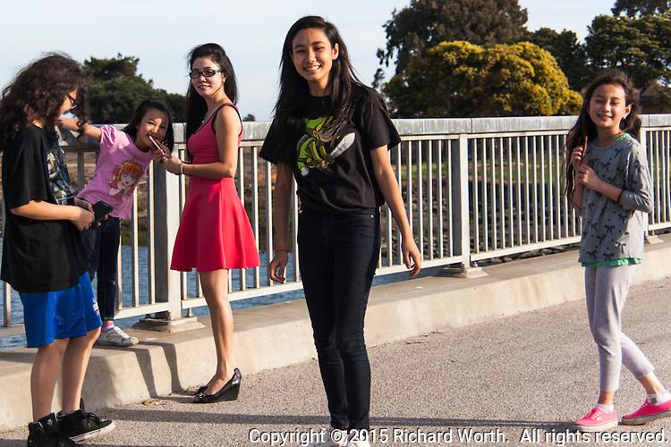 A group of young girls visiting the San Leadro Marina Park along San Francisco Bay.