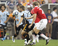 Bobby Convey #15 of the MLS All-Stars pushes the ball ahead of Darren Fletcher #24 of Manchester United during the 2010 MLS All-Star match at Reliant Stadium, on July 28 2010, in Houston, Texas. MANU won 5-2.