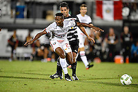 Orlando, FL - Saturday Jan. 21, 2017: São Paulo midfielder T. Mendes (23) is pushed by Corinthians midfielder Guilherme (10) during the first half of the Florida Cup Championship match between São Paulo and Corinthians at Bright House Networks Stadium.