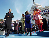 Washington, DC - January 20, 2009 -- United States President Barack Obama, left, and his wife, Michelle, and their daughters, Malia and Sasha, right, approach the podium for his swearing-in ceremony as 44th U.S. President at the U.S. Capitol in Washington, D.C., Tuesday, January 20, 2009.  Daughters Malia, center right, and Sasha, right, look on..Credit: Chuck Kennedy - Pool via CNP