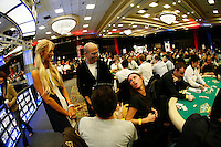3 March 2007: Celebrity Paris Hilton gets knocked out but sister Nikki Hilton continues playing a poker hand in action  during the fifth annual WPT Invitational at the Commerce Casino in Los Angeles, CA.  Nikki seen texting her sister in the casino via cell phone and chatting with Jeffrey Katzenberg.