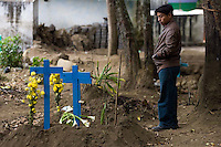 Fernando Mateo Xicay visits the graves of fellow Panabaj, Guatemala townspeople at the cemetery in nearby Santiago Atitlán, Guatemala on Tuesday, Nov. 1, 2005, part of the traditional Day of the Dead. Xicay said everyone in his family, 19 people, were killed when a massive mudslide covered the village of Panabaj on October 5. He also lost all of the horses with which he earned a living. Xicay has been living in a church shelter, but was told the shelter will close at the end of the week, and he has nowhere else to go. Torrential rains and mudslides associated with Hurricane Stan devasted some parts of western Guatemala. The Guatemalan government has put the number of dead at 669, and says that 31, 971 people are living in shelters. Locals say at least 500 people were killed at Panabaj.