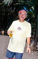 Contest Director Rod Brooks enjoys a beer and a cigar after the finish of the 1997 Quiksilver Pro in G-Land. Luke Egan (AUS) won the 1997 Quiksilver Pro at G-Land Indonesia on the East Coast of Java. Kelly Slater (USA) was runner up in the event. photo:  joliphotos.com