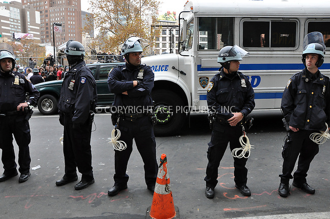 WWW.ACEPIXS.COM . . . . .  ....November 15 2011, New York City....Following a major crack-down by the New York Police Department which saw the Occupy Wall Street protestors tent city cleared out of Zuccotti Park, protestors milled arounds the area whilst the police and private security guards kept them from reoccupying the park area on November 15 2011 in New York City....Please byline: CURTIS MEANS - ACE PICTURES.... *** ***..Ace Pictures, Inc:  ..Philip Vaughan (212) 243-8787 or (646) 679 0430..e-mail: info@acepixs.com..web: http://www.acepixs.com