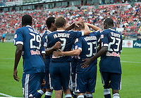 August 21 2010 New York Red Bulls midfielder Carl Robinson #33 is congratulated by the rest of his team after scoring a goal against his former team during a game between the New York Red Bulls and Toronto FC at BMO Field in Toronto..The New York Red Bulls won 4-1.
