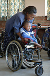 Anishah Masaire, 11, is a student at the Jairos Jiri School in Harare, Zimbabwe. She uses a wheelchair provided by the Jairos Jiri Association with support from CBM-US. Here she gets the padding in her wheelchair adjusted by Miriam Phiri, a staff member of the school.