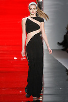 Ella walks runway in a ebony silk crepe peek-a-boo gown, from the Reem Acra Fall 2012 Feminine Power collection fashion show, during Mercedes-Benz Fashion Week New York Fall 2012 at Lincoln Center.