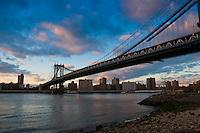 Manhattan bridge in the evening under bright pink skies