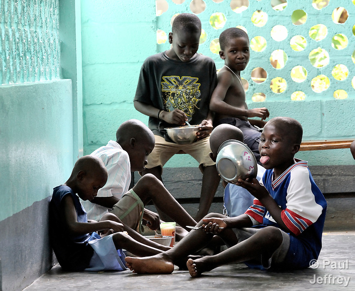 """Boys eating lunch at the """"House for the Dying"""", a hospice for AIDS patients and other seriously ill patients run by the Sisters of Charity in Port au Prince, Haiti."""