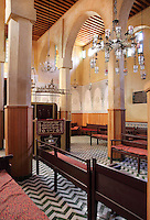 Main prayer room of the Slat Al Fassiyine Synagogue or Synagogue of the Prayers of the Fesians with pulpit and seating, built in the 17th century in the medina of Fes, Fes-Boulemane, Northern Morocco. The synagogue was built by Jews expelled from Andalusia who were not welcomed at other synagogues in Fes. The synagogue was closed in the 1960s but reopened in 2013 after restoration led by Simon Levy of the Judeo-Moroccan Cultural Society, with funding from Moroccoís Jewish community and the Federal Republic of Germany. The medina of Fes was listed as a UNESCO World Heritage Site in 1981. Picture by Manuel Cohen