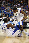 Freshman guard John Wall celebrates with Patrick Patterson before helping him off the ground during the first half of UK's second round  win over Wake Forest in the NCAA tournament at New Orleans Arena on Saturday, March 20, 2010. Photo by Britney McIntosh | Staff