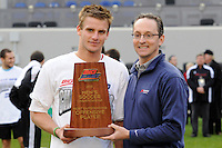 Colin Rolfe (9) of the Louisville Cardinals reveives the offensive player award. The Louisville Cardinals defeated the Providence Friars 3-2 in penalty kicks after playing to a 1-1 tie during the finals of the Big East Men's Soccer Championship at Red Bull Arena in Harrison, NJ, on November 14, 2010.