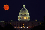 Around the equinoxes, the full moon rises due east behind the U.S. Capitol.