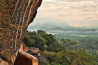 Part way up the face of the Sigiriya cliff the verdant fields and mountains of Sri Lanka open up. (Photo by Matt Considine - Images of Asia Collection)