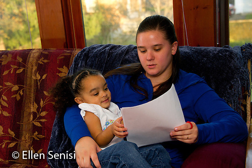 MR / Schenectady, NY. Toddler daughter (2, African American & Caucasian) looks on as her mother (21) reads paperwork. MR: Dal5, Dal6. ID: AL-HD. © Ellen B. Senisi (Ellen B. Senisi)
