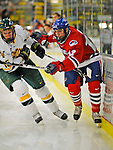 3 February 2008: University of Massachusetts Lowell River Hawks' forward Kory Falite, a Sophomore from Billerica, MA is checked by University of Vermont Catamounts' defenseman Kevan Miller, a Freshman from Los Angeles, CA, at Gutterson Fieldhouse in Burlington, Vermont. The Catamounts defeated the River Hawks 3-2...Mandatory Photo Credit: Ed Wolfstein Photo