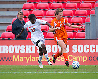 Shade Pratt (22) of Maryland fights for the ball with Ashley Flinn (5) of Miami during the game at Ludwig Field in College Park, MD.  Maryland defeated Miami, 2-1, in overtime.