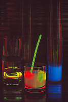 Concocted Alcoholic Drinks in Glasses against Black Background