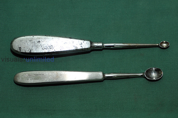 Curette is a spoon-shaped instrument for cleansing a diseased surface. Royalty Free