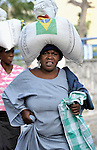 A woman takes home food she received from the World Food Program during a massive distribution in Port-au-Prince, Haiti, less than three weeks after the January 12 earthquake that ravaged the Caribbean nation.
