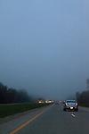Driving on a foggy evening, Michigan, USA