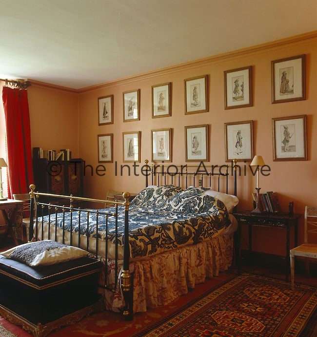 Brass and iron-framed bed in a simply furnished country bedroom