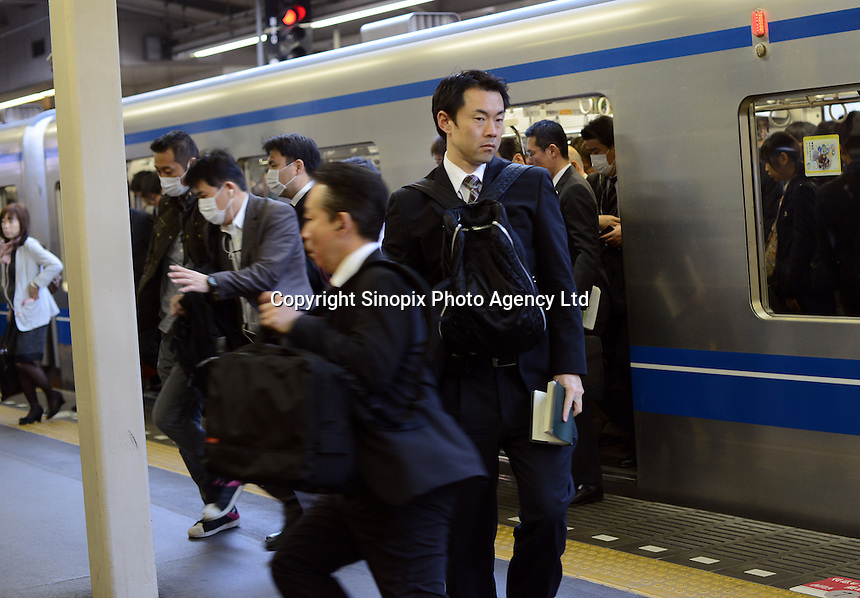 Businessmen rush for trains during the early morning commute, shinjuku Station, Tokyo. With up to 4 million passengers passing through it every day, Shinjuku station, Tokyo, Japan, is the busiest train station in the world. The station was used by an average of 3.64 million people per day.  That&rsquo;s 1.3 billion a year.  Or a fifth of humanity. Shinjuku has 36 platforms, and connects 12 different subway and railway lines.  Morning rush hour is pandemonium with all trains 200% full. <br /> <br /> Photo by Richard jones / sinopix