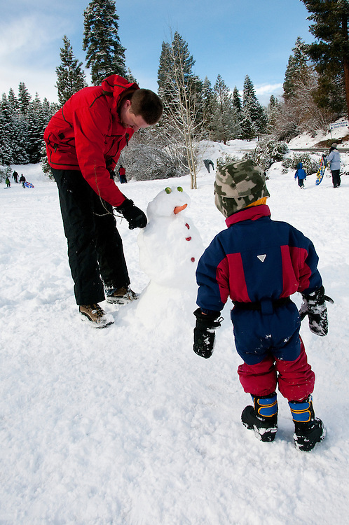 California, Lake Tahoe: Child makes a snow man at  North Lake Tahoe Regional Park.  Photo copyright Lee Foster.  Photo # cataho107565