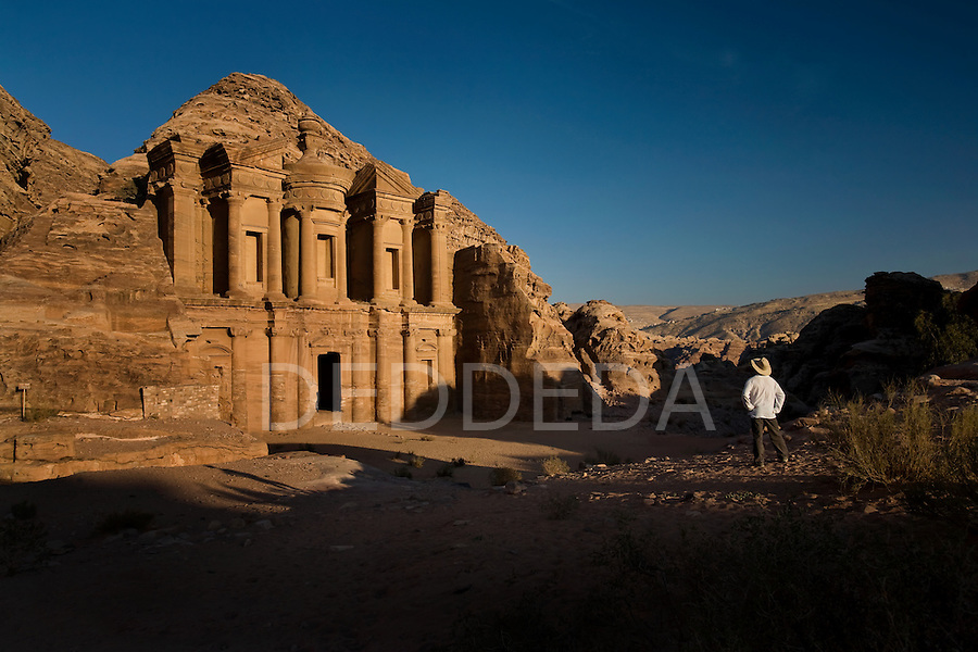 A male tourist visits the Al-Deir, or Monastery, one of the most magnificent sights in the Nabatean ancient city of Petra, Jordan.