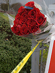 Flowers left near the scene of a shooting that killed four Lakewood Police Officers in Lakewood on Sunday, Nov. 29, 2009.  At about 8:00 this morning, a gunman walked into the Forza Coffee shop while the four police officers were having coffee before their shift started and opened fire, killing all our law enforcement.  Jim Bryant Photo. ©2010. ALL RIGHTS RESERVED.