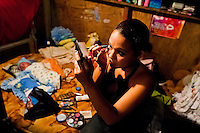 Bianca Rocio, a Salvadorean dancer, applies makeup in her trailer before a dancing performance at the Circo Brasilia, a family run circus travelling in Central America, 10 May 2011. The Circo Brasilia circus belongs to the old-fashioned traveling circuses with a usual mixture of acrobat, clown and comic acts. Due to the general loss of popularity caused by modern forms of entertainment such as movies, TV shows or internet, these small family enterprises balance on the edge of survival. Circuses were pushed away and now they have to set up their shows in more remote villages. The circus art and culture is slowly dying in Latin America.